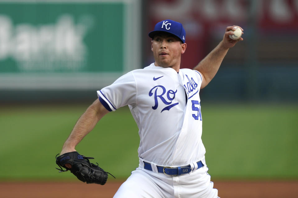 Kansas City Royals starting pitcher Kris Bubic throws during the first inning of a baseball game against the Milwaukee Brewers Tuesday, May 18, 2021, in Kansas City, Mo. (AP Photo/Charlie Riedel)