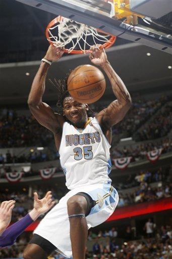 Denver Nuggets rookie forward Kenneth Faried dunks the ball for a basket against the Los Angeles Lakers in the fourth quarter of Game 3 of the Nuggets' 99-84 victory in the teams' first-round NBA playoff series in Denver on Friday, May 4, 2012. (AP Photo/David Zalubowski)