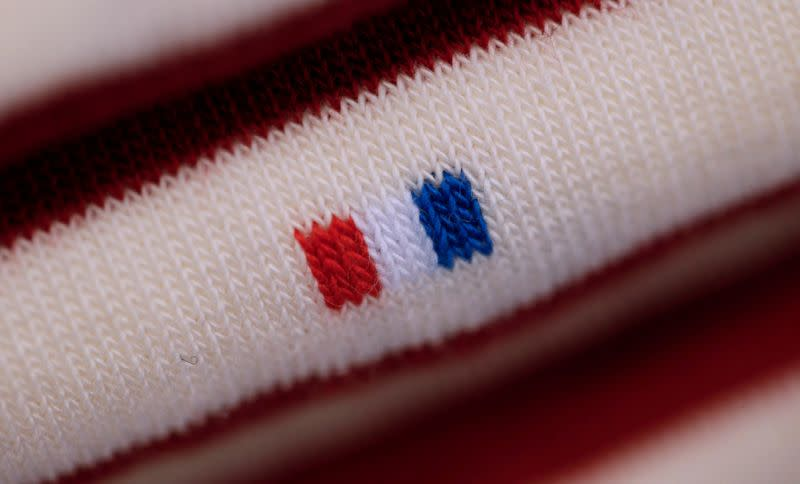 """FILE PHOTO: A French flag is seen on a pair of socks displayed at the """"Made In France"""" fair in Paris"""