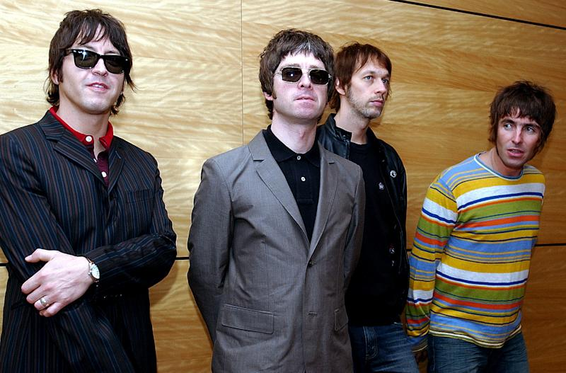 Members of British rock band Oasis pose for photos ahead of a concert in Hong Kong on Saturday, February 25, 2006. From left are, Gem Archer, Noel Gallagher, Andy Bell, and Liam Gallagher. (AP Photo/Lo Sai Hung)