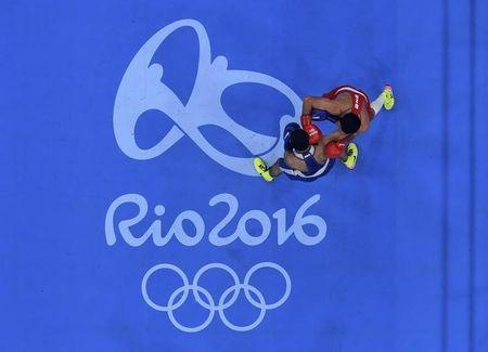 2016 Rio Olympics - Boxing - Final - Men's Fly (52kg) Final Bout 271 - Riocentro - Pavilion 6 - Rio de Janeiro, Brazil - 21/08/2016. Shakhobidin Zoirov (UZB) of Uzbekistan and Misha Aloian (RUS) of Russia compete. REUTERS/Pool