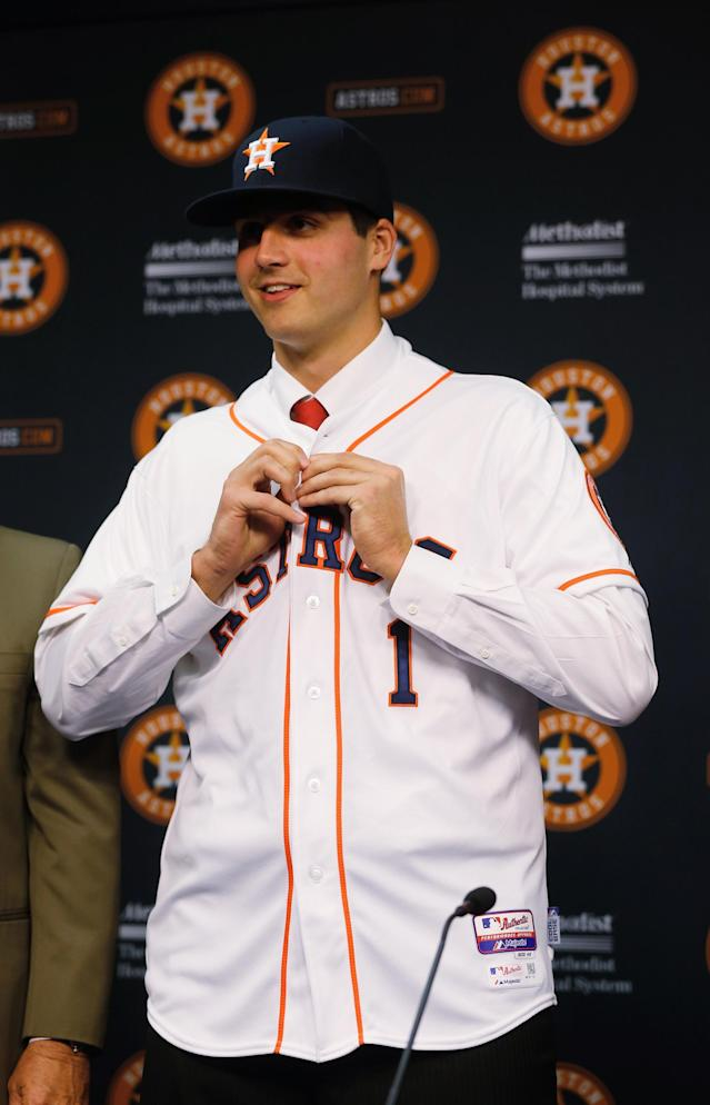HOUSTON, TX - JUNE 19: Houston Astros first overall draft pick Mark Appel puts on a jersey after signing with the team prior to the start of the game between the Milwaukee Brewers and the Houston Astros at Minute Maid Park on June 19, 2013 in Houston, Texas. (Photo by Scott Halleran/Getty Images)