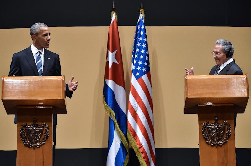 US President-elect Donald Trump says President Barack Obama, seen with Fidel Castro's brother Cuban President Raul Castro (R) in Cuba in March 2016, has gone too far is his efforts to normalize relations between the US and Cuba (AFP Photo/Nicholas Kamm)