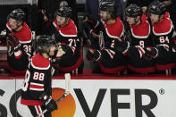 Chicago Blackhawks' Patrick Kane (88) celebrates with teammates after scoring a goal against the Detroit Red Wings during the third period of an NHL hockey game in Chicago, Sunday, Feb. 28, 2021. It was 400th goals from Patrick Kane. (AP Photo/Nam Y. Huh)