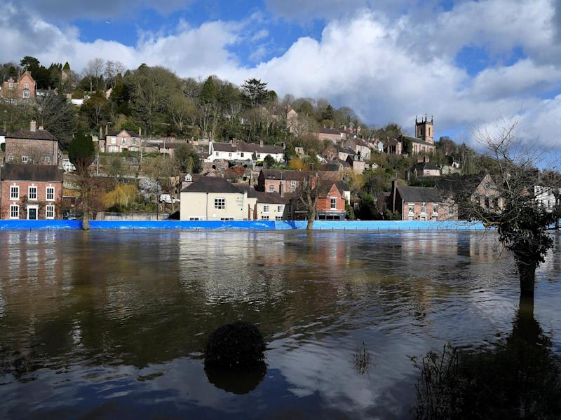Flood defences are seen after being pushed back by high water levels on the River Severn, Ironbridge, on February 27, 2020: REUTERS/Toby Melville