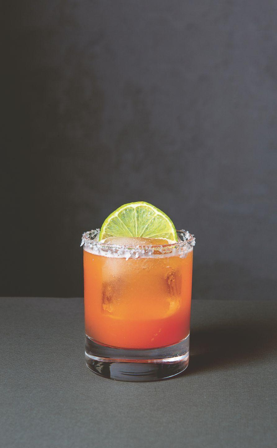 """<p>""""The combination of sweet carrots, tart lime, and spicy Ginger Syrup makes for a delicious riff in this cocktail created by Tamer Hamawi of New York's Gran Eléctrica,"""" writes Stillman in <em>Spirited</em>. Plus, this drink is absolutely beautiful!</p><p><strong>Ingredients:</strong></p><p>1 1/2 ounce (45 ml) blanco tequila<br>1/2 ounce (15 ml) triple sec<br>1 ounce (30 ml) fresh lime juice<br>1 ounce (30 ml) carrot juice<br>1/2 ounce (15 ml) Ginger Syrup (p. 24)<br>Lime wedge, dehydrated lime zest<br>Sea salt, for salt rim<br>Lime wheel, to garnish</p><p><strong>Directions:</strong></p><p>For the lime salt rim, combine 1 part dried lime zest to 4 parts sea salt in a shallow saucer. Rub the rim of a rocks glass with a lime wedge and dip the glass into the salt mixture. Shake off any excess. Combine all the ingredients in a cocktail shaker filled with ice<br>and shake vigorously for 15–20 seconds, or until frosted on the outside. Strain into the glass with fresh ice. Garnish with a lime wheel.<em><br></em></p><p><em>Reprinted from <a href=""""https://urldefense.com/v3/__https://www.phaidon.com/store/food-cook/spirited-9781838661618/__;!!Ivohdkk!wgMkltU-PaHO4HwAVgN1ZFQIkGJX2DBDWVQcsLmV_D1J41V697waOxGzbEoMnsIgEg$"""" rel=""""nofollow noopener"""" target=""""_blank"""" data-ylk=""""slk:Spirited: Cocktails from Around the World"""" class=""""link rapid-noclick-resp"""">Spirited: Cocktails from Around the World</a> by Adrienne Stillman. © 2020 Phaidon Press</em></p>"""