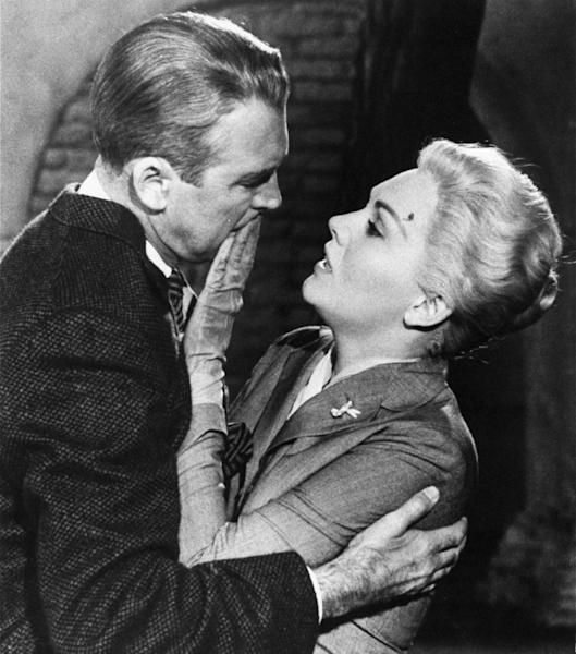 """FILE - This undated film image released by Paramount shows, Jimmy Stewart, left, and Kim Novak, in a scene from Alfred Hitchcock's 1958 film, """"Vertigo."""" (AP Photo/Paramount Pictures, file)"""