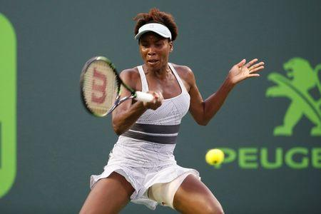 Mar 25, 2016; Key Biscayne, FL, USA; Venus Williams hits a forehand against Elena Vesnina (not pictured) during day four of the Miami Open at Crandon Park Tennis Center. Vesnina won 6-0, 6-7(5), 6-2. Mandatory Credit: Geoff Burke-USA TODAY Sports