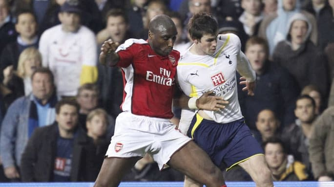 Arsenal's Sol Campbell (L) challenges To