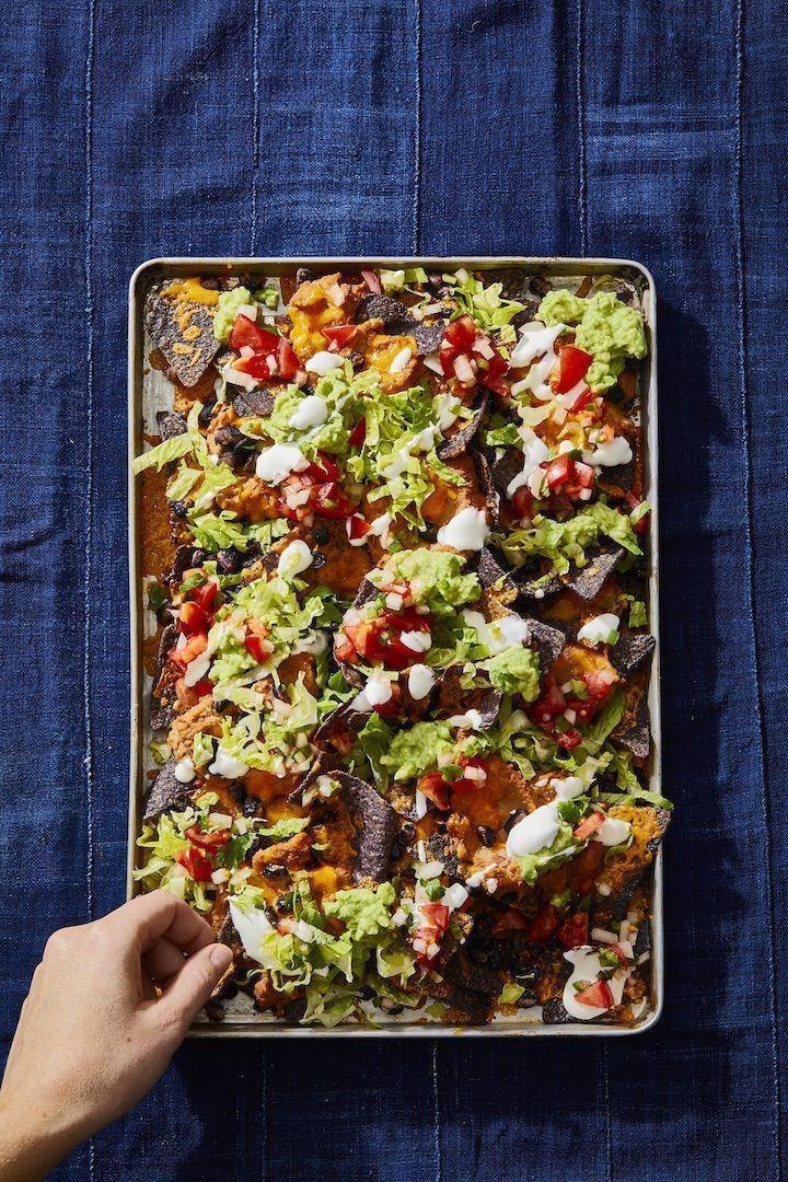 """<p>The more, the merrier: Layer refried and black beans on a bed of tortilla chips to get your protein fix.</p><p><em><a href=""""https://www.goodhousekeeping.com/food-recipes/a29960234/how-to-make-nachos-recipe/"""" rel=""""nofollow noopener"""" target=""""_blank"""" data-ylk=""""slk:Get the recipe for Double Bean Nachos »"""" class=""""link rapid-noclick-resp"""">Get the recipe for Double Bean Nachos »</a></em></p>"""