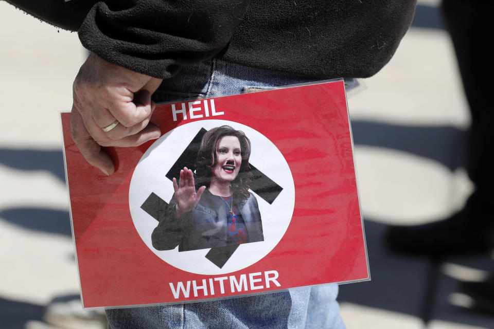From a demonstration outside the Michigan State Capitol in Lansing on Wednesday. (Jeff Kowalsky/AFP via Getty Images)