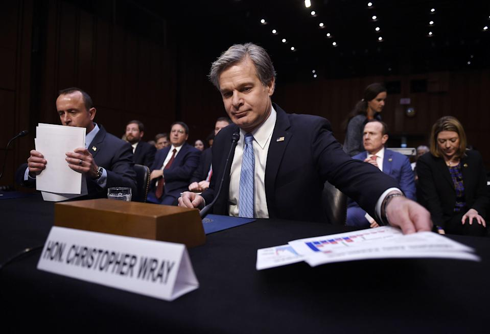 FBI Director Christopher Wray says the bureau shared information about domestic threats with Washington law enforcement before the Capitol riot.