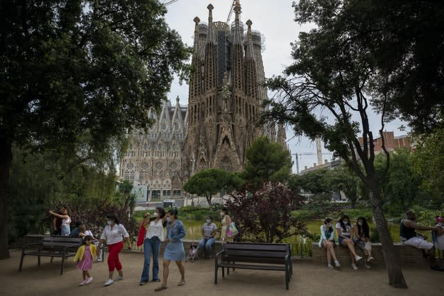 Local visitors in a park next to La Sagrada Familia basilica in Barcelona (Emilio Morenatti/AP)