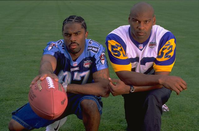 "Kevin Dyson, left, and Mike Jones became friends since ""The Tackle"" ended Super Bowl XXXIV. (Getty Images)"