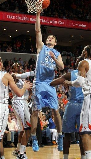 North Carolina forward Tyler Zeller (44) shoots the ball next to Virginia forward Akil Mitchell (25), left, during the first half of an NCAA college basketball game on Saturday, Feb. 25, 2012, in Charlottesville, Va.  (AP Photo/Andrew Shurtleff)