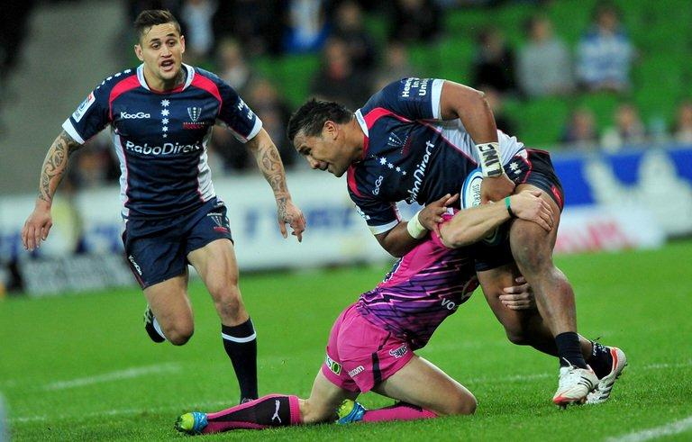 Melbourne Rebels' Cooper Vuna (R) is tackled by a Northern Bulls player, in Melbourne, on May 4, 2012