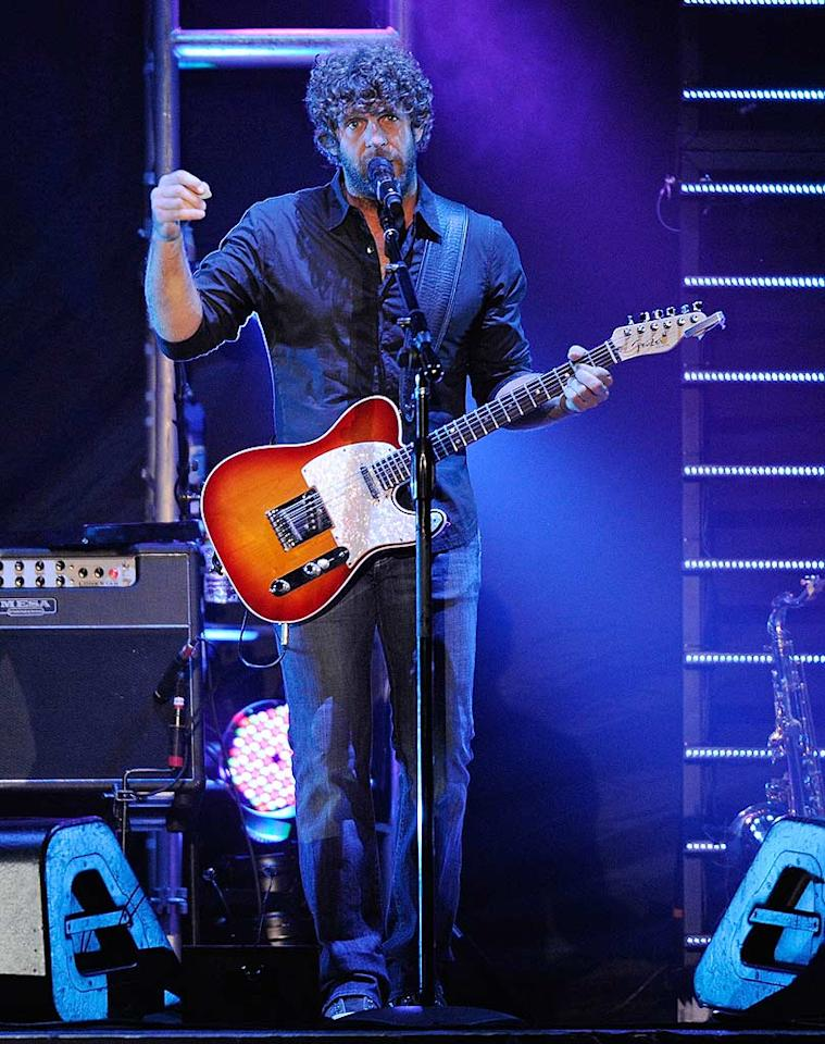 "Artist Billy Currington warmed up the crowd. The curly-haired crooner promoted his new album, <i>Enjoy Yourself</i>, and his latest single, ""Let Me Down Easy."" Frederick Breedon/<a href=""http://www.wireimage.com"" target=""new"">WireImage.com</a> - October 13, 2010"