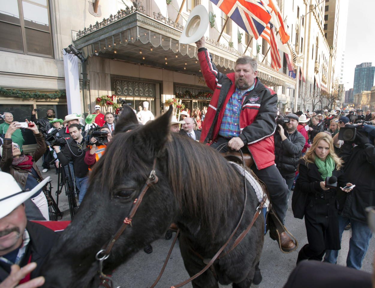 Fletcher Armstrong, with the Calgary Grey Cup committee rides his horse, Marty, past the Royal York hotel Thursday, Nov. 22, 2012 in Toronto. Calgary Stampeders will play the Toronto Argonauts in the Canadian Football League Grey Cup Sunday, Nov. 25, 2012. THE CANADIAN PRESS/Ryan Remiorz