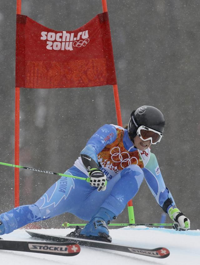 Slovenia's Tina Maze passes a gate in the second run of the women's giant slalom to win the gold medal at the Sochi 2014 Winter Olympics, Tuesday, Feb. 18, 2014, in Krasnaya Polyana, Russia. (AP Photo/Luca Bruno)