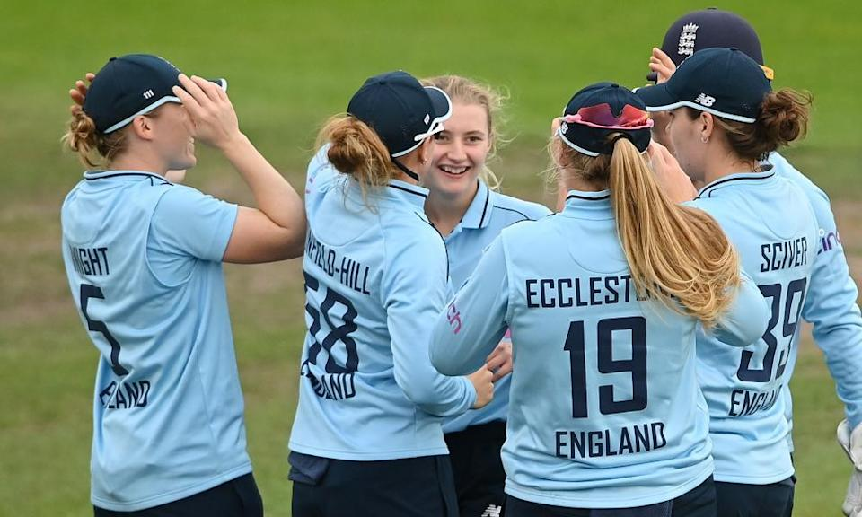 Charlie Dean is congratulated after taking the wicket of New Zealand's Katey Martin