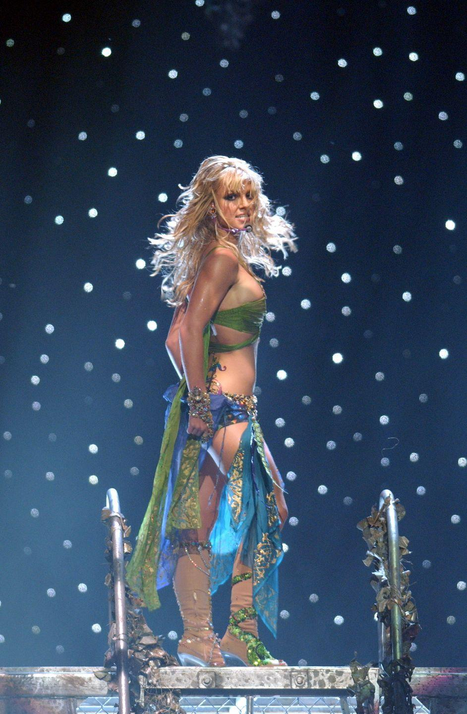 """<p>Britney Spears performed her single """"Slave 4 U"""" in this scarf-themed outfit, which she later accessorized with a live python, in 2001.</p>"""