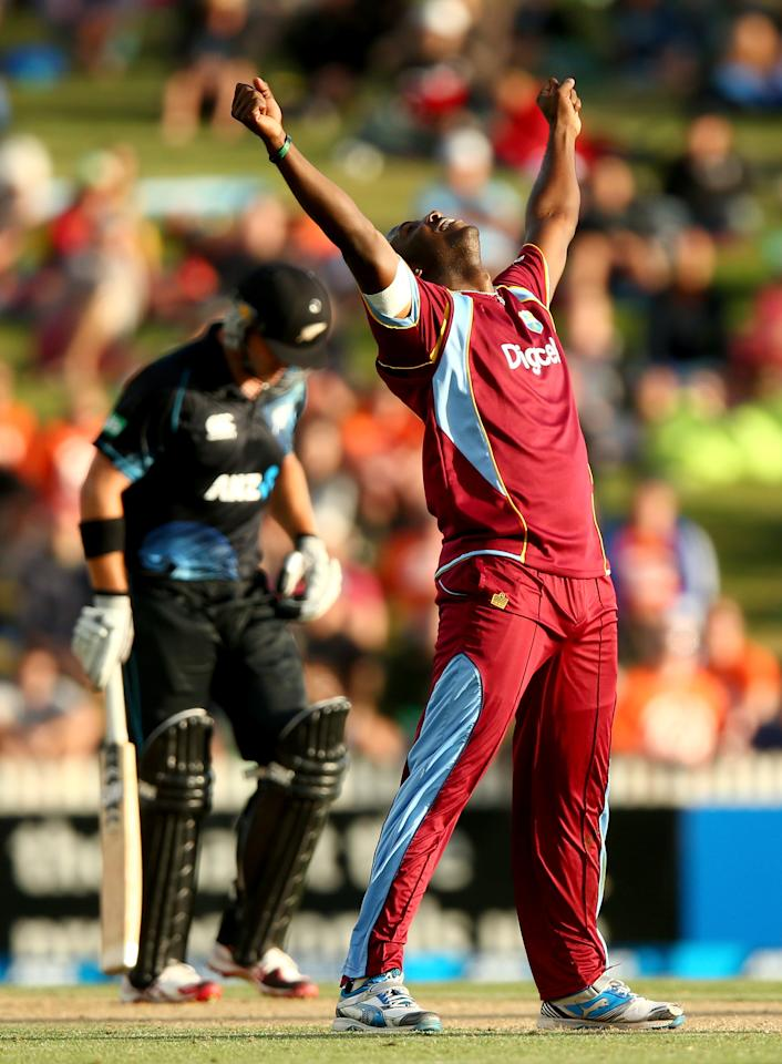 HAMILTON, NEW ZEALAND - JANUARY 08: Andre Russell of the West Indies celebrates his wicket of Corey Anderson of New Zealand (L) during game five of the One Day International Series between New Zealand and the West Indies at Seddon Park on January 8, 2014 in Hamilton, New Zealand.  (Photo by Phil Walter/Getty Images)