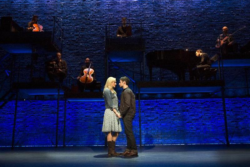 """This theater image released by The Hartman group shows Adam Kantor, right, and Betsy Wolfe during a performance of """"The Last Five Years,"""" in New York. (AP Photo/The Hartman Group, Joan Marcus)"""