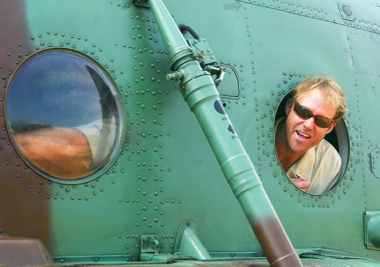 GALLE, SRI LANKA - MARCH 13:  Matthew Hayden of Australia looks out of the Air Force Helicopter before flying to Kandy with his team mateson March 13, 2004 in Galle, Sri Lanka. (Photo by Hamish Blair/Getty Images)