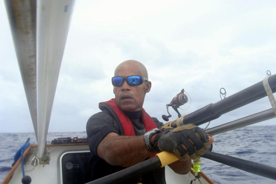In this undated photo provided by G.C. Media, Victor Mooney rows the Spirit of Malabo in the Atlantic Ocean. Mooney who hopes to cross the Atlantic Ocean in honor of his brother who died of AIDS in 1983, passed the halfway mark, Sunday, May 11, 2014. He has tried the same feat three other times, without success. (AP Photo/G.C. Media)