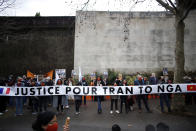 Activists hold a banner reading « Justice for Tran To Nga » during a gathering in support of people exposed to Agent Orange during the Vietnam War, in Paris, Saturday Jan. 30, 2021. Activists gathered Saturday in Paris in support of people exposed to Agent Orange during the Vietnam War, after a French court examined a case opposing a French-Vietnamese woman to 14 companies that produced and sold the toxic chemical. (AP Photo/Thibault Camus)