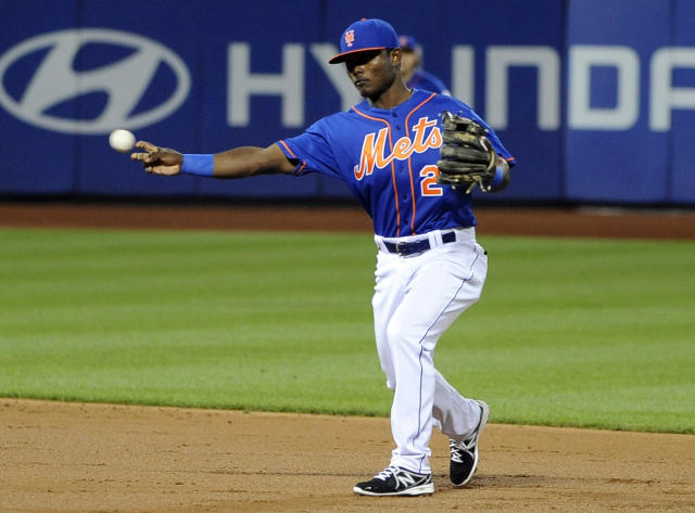 New York Mets second baseman Dilson Herrara throws out Philadelphia Phillies' Grady Sizemore in the second inning of a baseball game at Citi Field on Friday, Aug. 29, 2014, in New York. (AP Photo/Kathy Kmonicek)