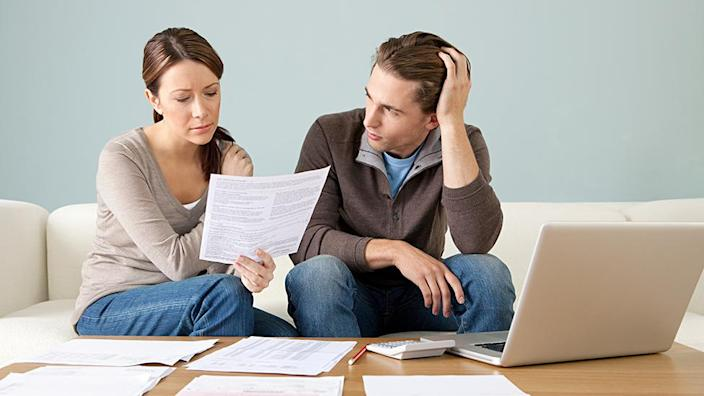 Couple looking worried about bills