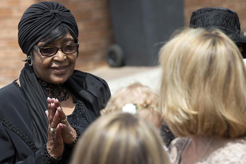 Winnie Madikizela-Mandela, left, Nelson Mandela's former wife, greets worshippers at the Bryanston Methodist Church in Bryanston suburb of Johannesburg, South Africa, Sunday Dec. 8, 2013. South Africa is readying itself for the arrival of a flood of world leaders for the memorial service and funeral for Nelson Mandela as thousands of mourners continued to flock to sites around the country Saturday to pay homage to the freedom struggle icon. (AP Photo/Peter Dejong)