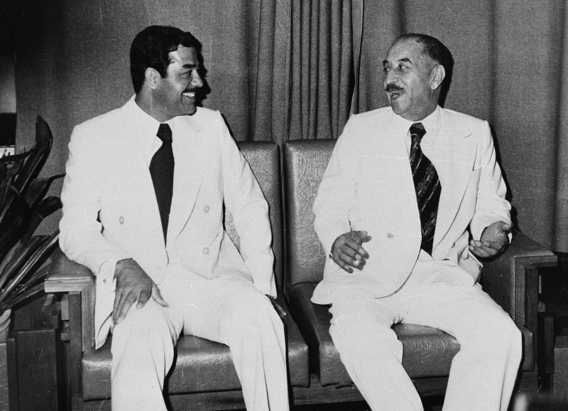 FILE - In this November 1978 file photo, Iraqi President Ahmed Hassan al-Bakr, right, and Saddam Hussein sit together in Baghdad. North Korea's execution of Kim Jong-Un's uncle, on Thursday, Dec. 12, 2013, reminds many of the ways in which 20th century dictators such as Josef Stalin, Adolf Hitler, Mao Zedong and Hussein methodically ousted their opponents. Hussein led at least two purges in Iraq. In 1968, the Baath Party regained power under the leadership of al-Bakr, a distant cousin of Saddam. As his deputy, Saddam purged key party figures. Eleven years later, Saddam forced al-Bakr to resign — and hundreds of Baath and military officials were executed. (AP Photo/File)