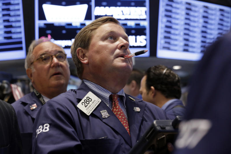 Trader Stephen Mara, center, works on the floor of the New York Stock Exchange, Tuesday, Aug. 27, 2013. Worries about a potential military strike against Syria are dragging down the U.S. stock market in early trading. (AP Photo/Richard Drew)