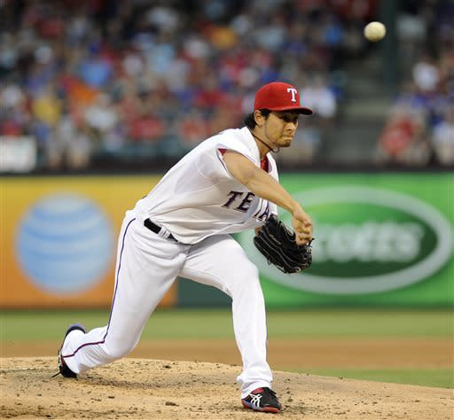 Texas Rangers starting pitcher Yu Darvish, of Japan, throws in the second inning during a baseball game against the Chicago White Sox, Tuesday, April 30, 2013, in Arlington, Texas. (AP Photo/Matt Strasen)