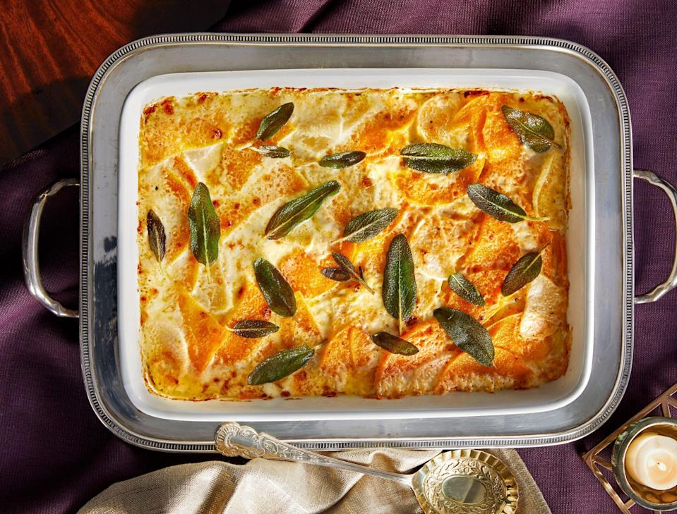 """<p><strong>Recipe: <a href=""""https://www.southernliving.com/recipes/root-vegetable-butternut-squash-gratin"""" rel=""""nofollow noopener"""" target=""""_blank"""" data-ylk=""""slk:Root Vegetable-and-Butternut Squash Gratin"""" class=""""link rapid-noclick-resp"""">Root Vegetable-and-Butternut Squash Gratin</a></strong></p> <p>This is the festive seasonal casserole you never knew you needed. It's creamy, cheesy, and topped with aromatic sage. </p>"""