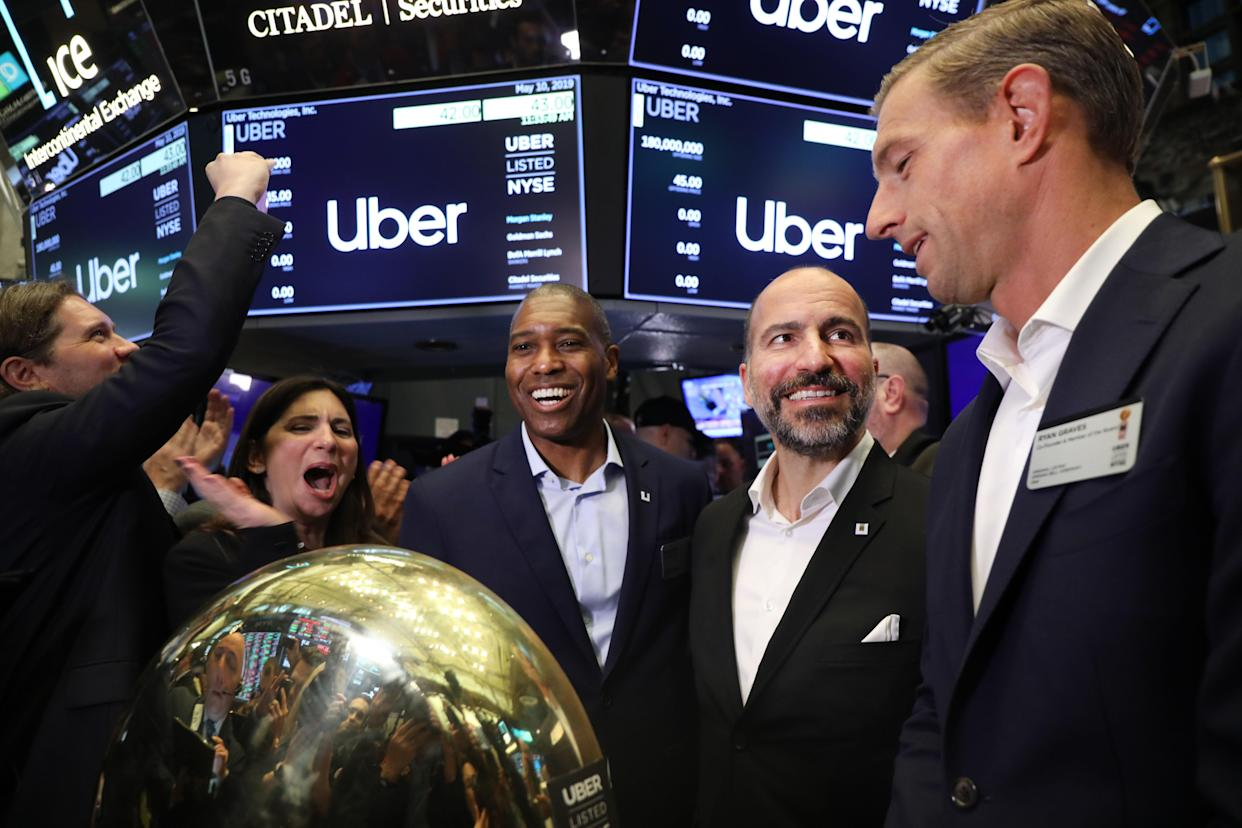 Uber co-founder Ryan Graves (right) stands with CEO Dara Khosrowshahi on the floor before ringing a ceremonial bell signifying the company's first trade. The ride-hailing startup is one of this year's high-profile IPOs even as the number of public debuts remains historically low. (Photo by Spencer Platt/Getty Images)