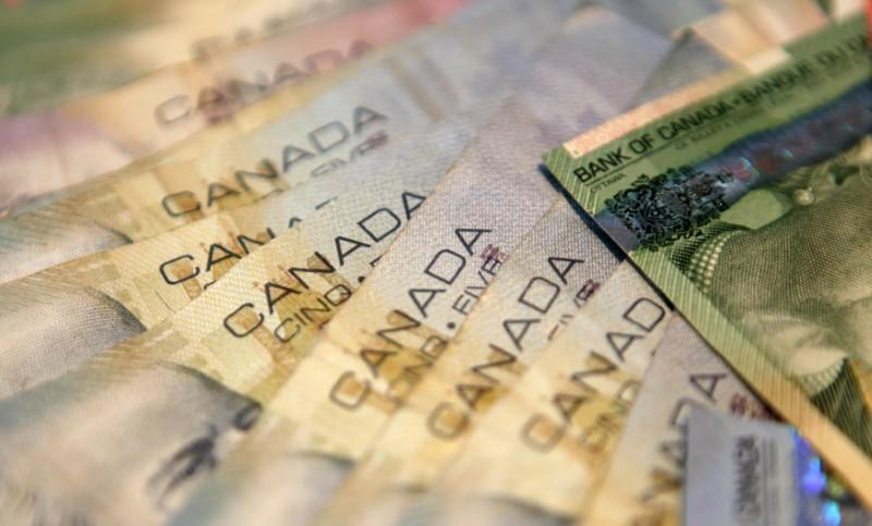 An Ilration Picture Shows Canadian Banknotes Of Five Dollars In Reykjavik