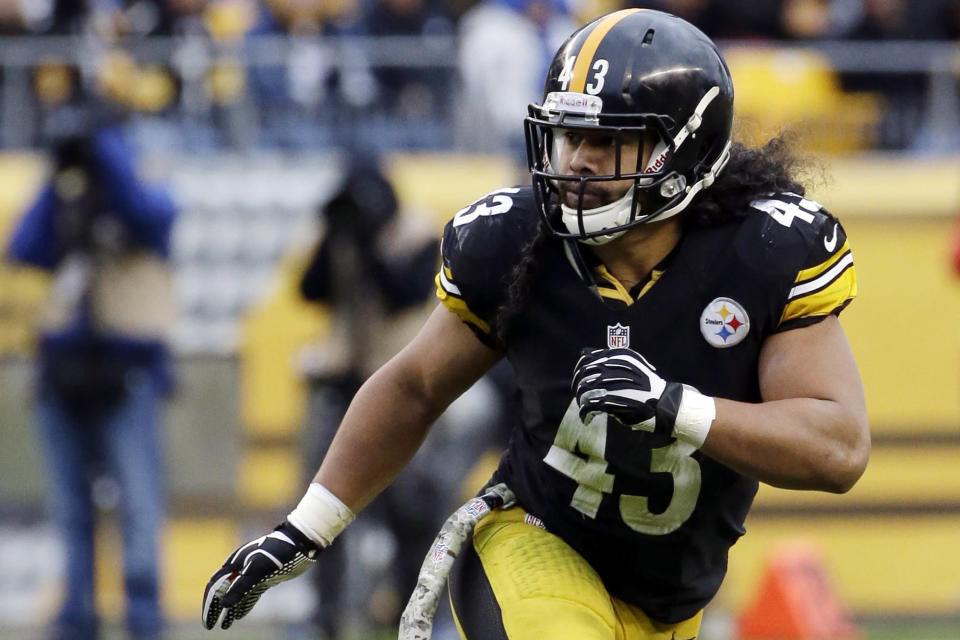 FILE - In this Nov. 10, 2013, file photo, Pittsburgh Steelers' Troy Polamalu follows the action during the second half of an NFL football game against the Buffalo Bills in Pittsburgh. Polamalu has carved his own unique path to the Hall of Fame. (AP Photo/Gene J. Puskar, File)