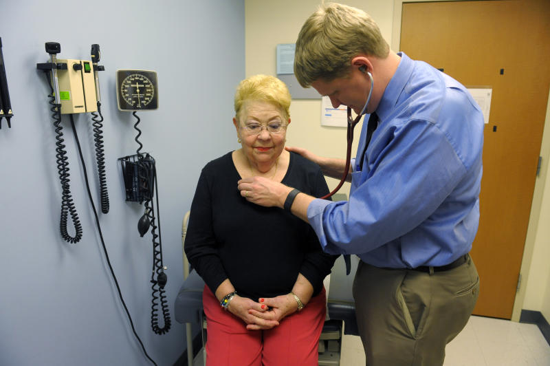 ALEXANDRIA, VA - DECEMBER 17: Family doctor Alex Krist listens to Jane Duncan's heartbeat during her office visit December 17, 2015 in Alexandria, VA. Krist is part of the volunteer doctor panel, the US Preventive Services Task force, that makes recommendations about preventive health services. (Photo by Katherine Frey/The Washington Post via Getty Images)