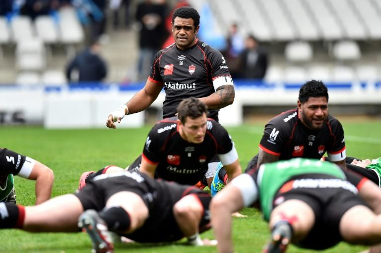 Lyon's Fiji winger Napolioni Nalaga (rear C) warms up with teammates prior to the French Top 14 rugby union match between Lyon (LOU) and Montpellier (MHR) on March 5, 2017, at the Gerland stadium, in Lyon, central eastern France