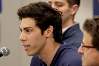 Milwaukee Brewers' Christian Yelich speaks after the Brewers announced his multi-year contract extension at the teams' spring training facility Friday, March 6, 2020, in Phoenix. (AP Photo/Matt York)