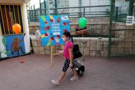 A pupil, wearing protective face mask, arrives at school as Israel reopens first to fourth grades, continuing to ease a second nationwide coronavirus disease (COVID-19) lockdown, at a school in Rehovot