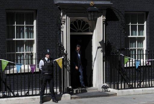 Mitt Romney leaves after meeting David Cameron at Downing Street