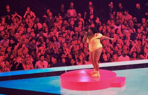 US singer Lizzo -- seen here performing during the 2019 MTV Video Music Awards in August 2019 -- earned eight Grammy nominations to lead the field