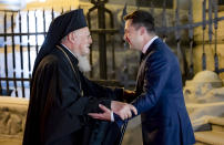 Ukrainian President Volodymyr Zelenskiy, right, greets Ecumenical Patriarch Bartholomew I during their meeting in Kyiv, Ukraine, Saturday, Aug. 21, 2021. Bartholomew I, arrived to Kyiv to mark the 30th anniversary of Ukraine's independence that is celebrated on Aug. 24.(Ukrainian Presidential Press Office via AP)