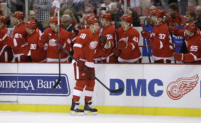 Detroit Red Wings center Joakim Andersson (18) of Sweden is congratulated by teammates after scoring during the first period of an NHL hockey game against the Toronto Maple Leafs in Detroit, Friday, Sept. 27, 2013. (AP Photo/Carlos Osorio)