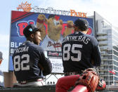"""Atlanta Braves prospects Ronald Acuna Jr., left, and catcher William Contreras take in the scene as they prepare to play in the """"Future Stars"""" exhibition baseball game against the Atlanta Braves on Tuesday, March 27, 2018, in Atlanta. (Curtis Compton/Atlanta Journal-Constitution via AP)"""