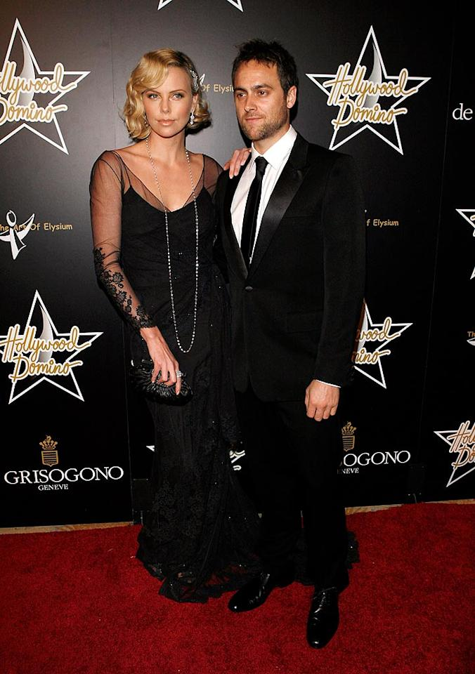 "Although Charlize Theron and her beau Stuart Townsend are planning to watch the Oscars at home this weekend, the gorgeous couple didn't want to miss out on the Domino Tournament! Jean Baptiste Lacroix/<a href=""http://www.wireimage.com"" target=""new"">WireImage.com</a> - February 21, 2008"